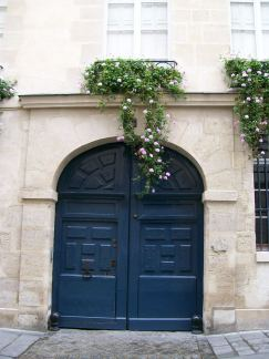 Beautiful doors and window flowers in Paris, France.
